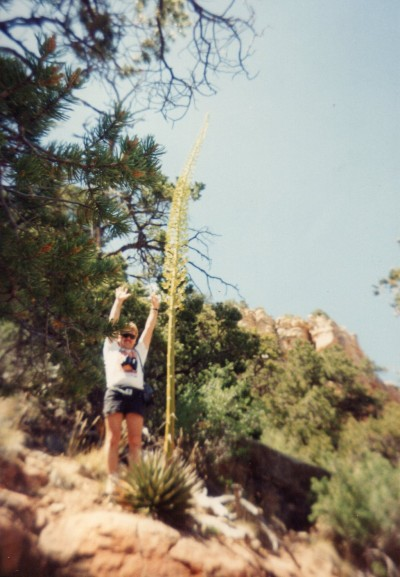 My dad showing us how tall this tall cactus really was!